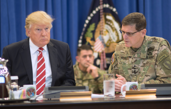 President Donald Trump discusses current military operations with Gen. Joseph Votel, commander of U.S. Central Command Commander, at MacDill, AFB, FL, Feb. 6, 2017. (DoD photo by D. Myles Cullen/Released)